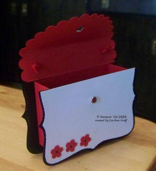Big Shot red black purse box inside lid